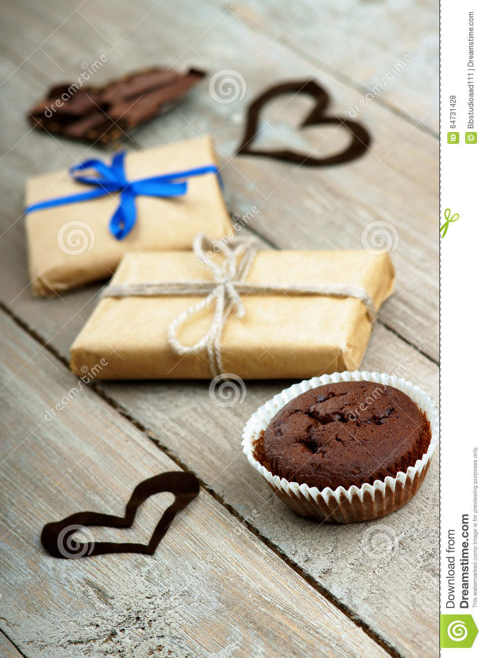 Chocolate muffin, gift boxes and heart shapes