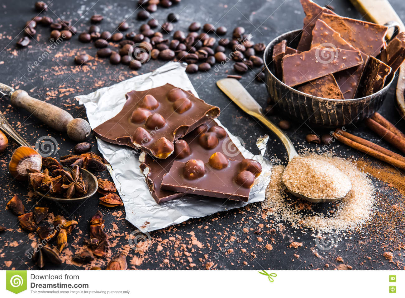 Chocolate with nuts and spices on a table
