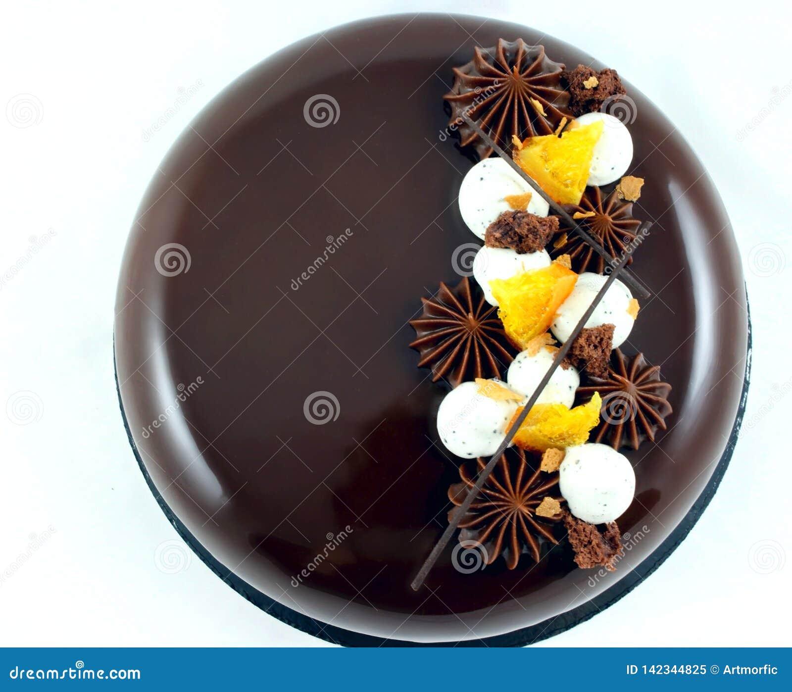 Chocolate and orange cake with chocolate ganache stars and whipped cream top view
