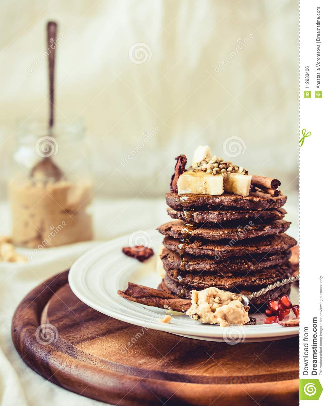 Chocolate pancakes with banana, peanut butter, green buckwheat a