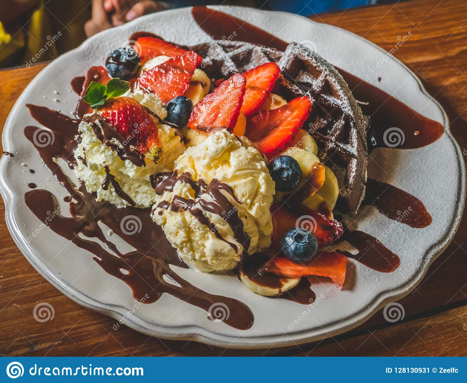 Chocolate Pancakes With Banana Strawberry Blueberry Whipping Cream And Vanilla Ice Cream Icing Sugar Brownies And Chocolate S Stock Image Image Of Lunch Crepes 128130931
