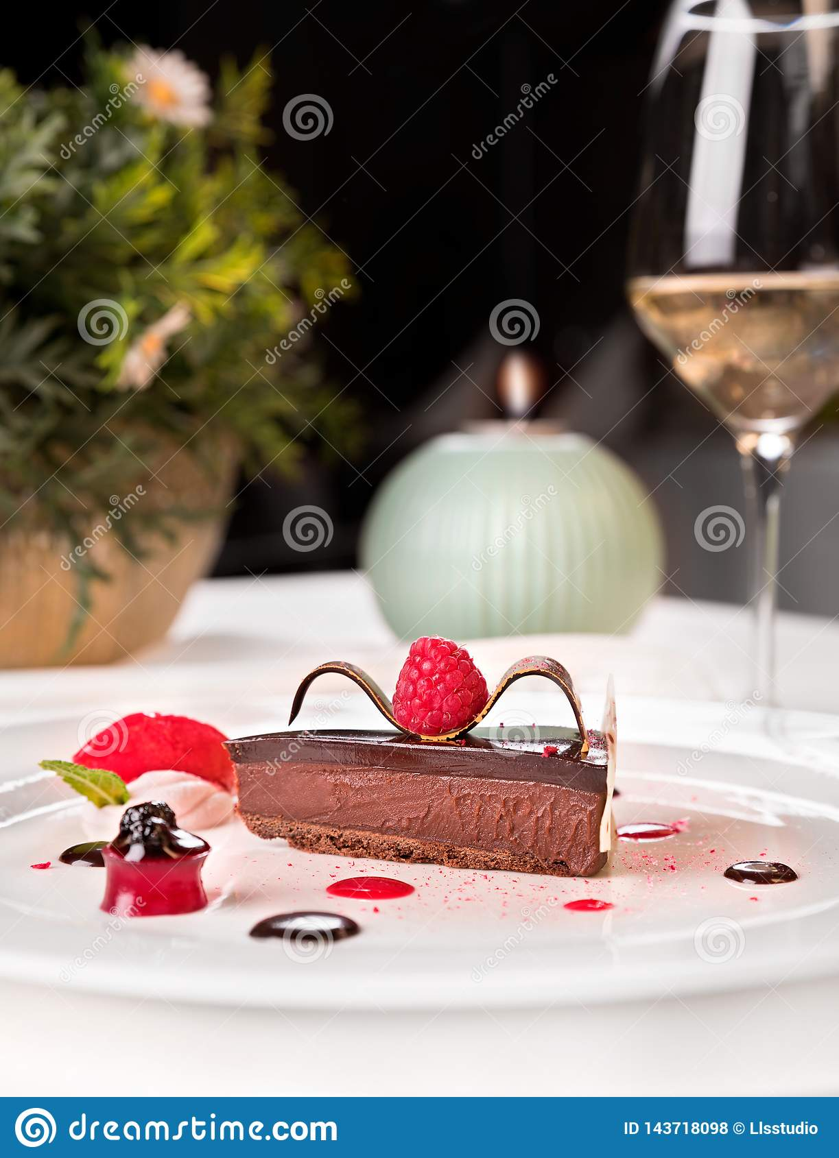 Chocolate and raspberries palette, served in a white plate