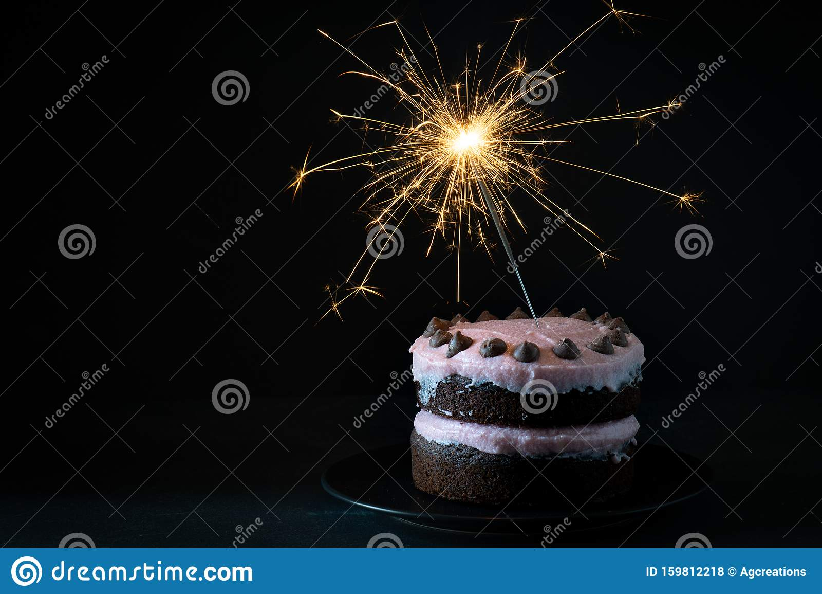 Peachy Chocolate Cake With Sparkler Dark Background Stock Photo Image Funny Birthday Cards Online Inifodamsfinfo
