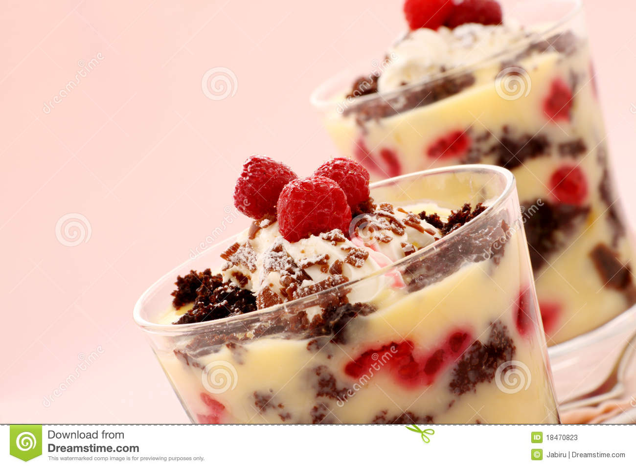 ... chocolate trifle dessert served in two glasses topped with raspberries