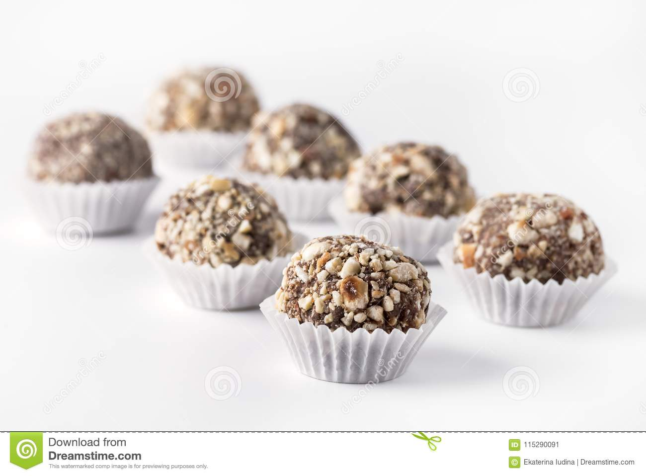 Chocolate Truffles Decorated With Nuts On White Background Beautiful