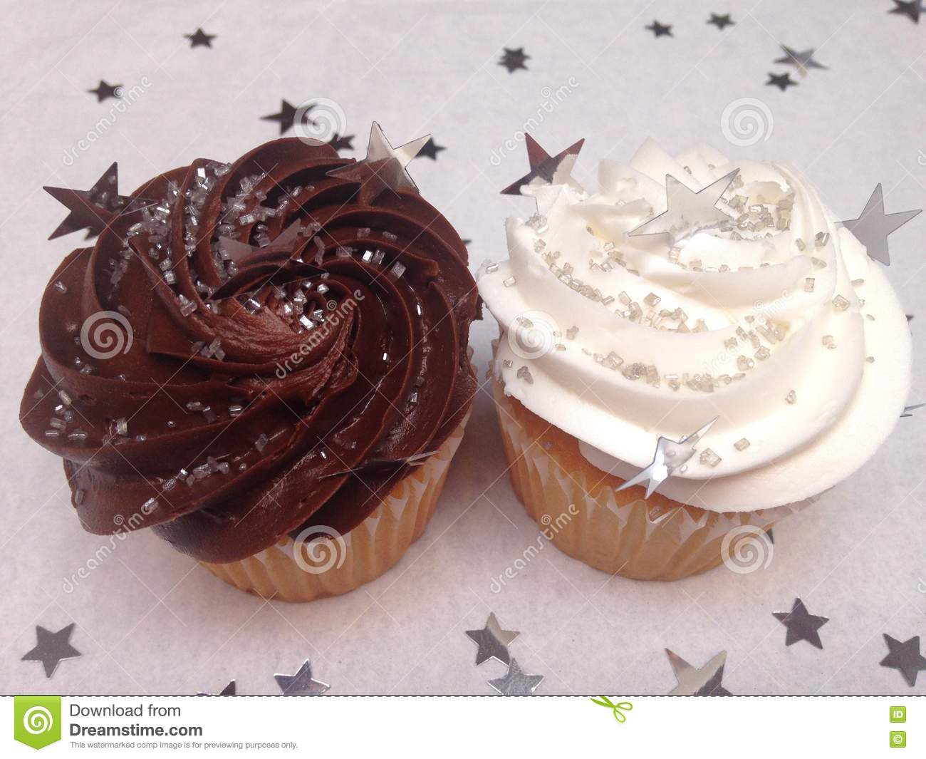 Chocolate And Vanilla Cupcakes With Sprinkles Stock Image