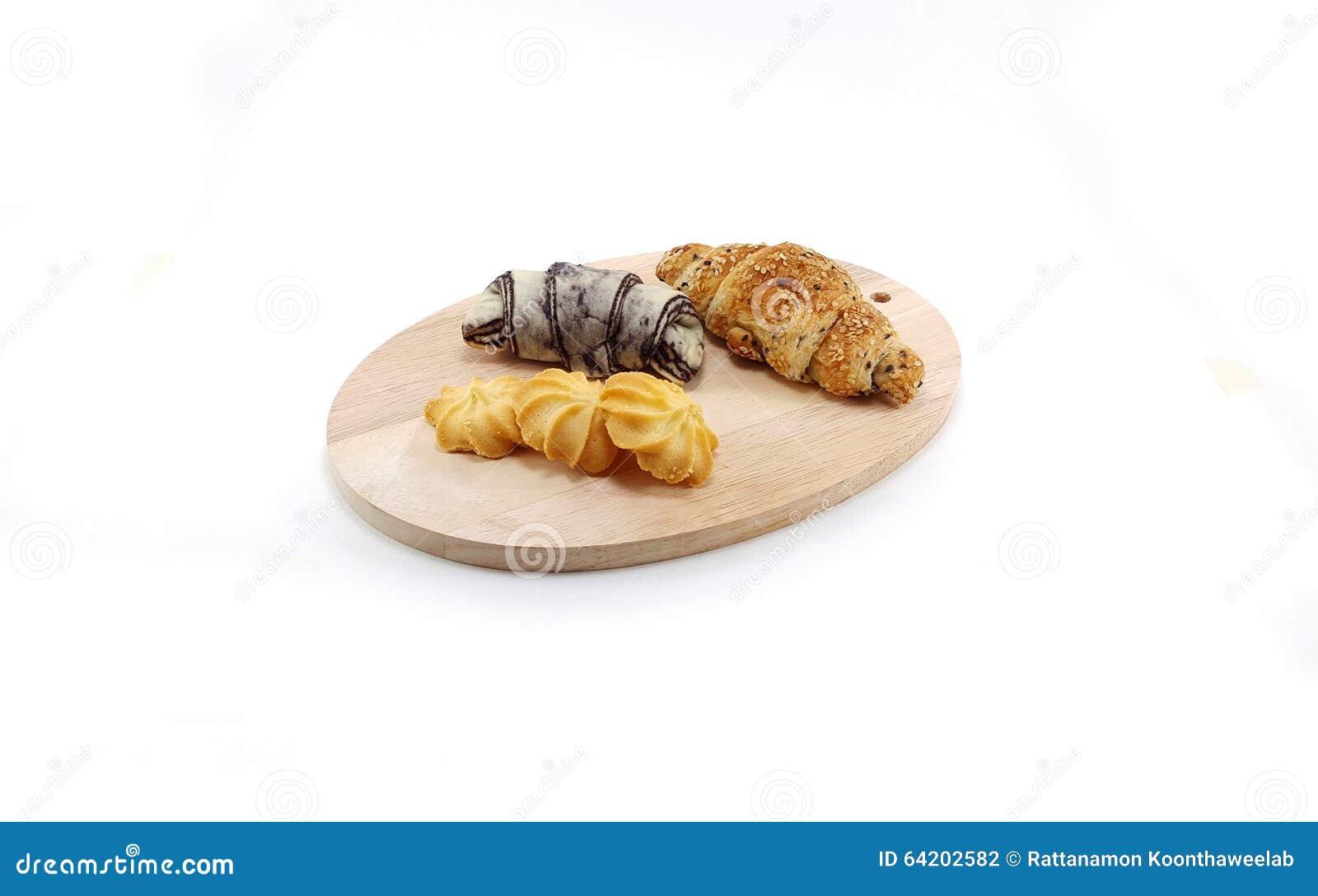 Chocolate y cruasán negro del sésamo con la galleta de mantequilla