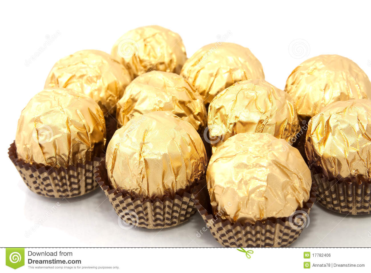 Chocolates In A Gold Wrapper Royalty Free Stock Image - Image ...