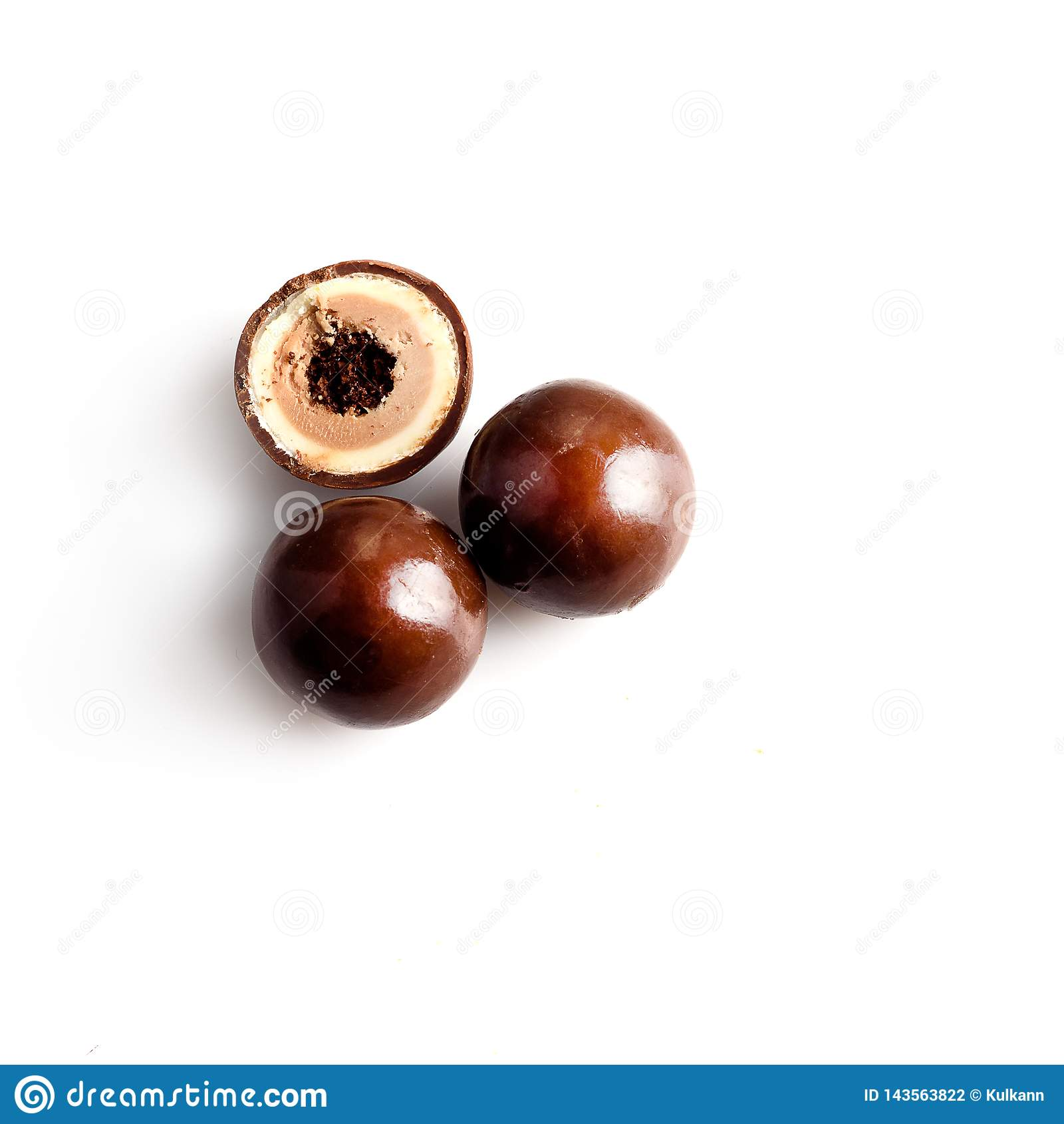 Chocolates on a white background, three pieces