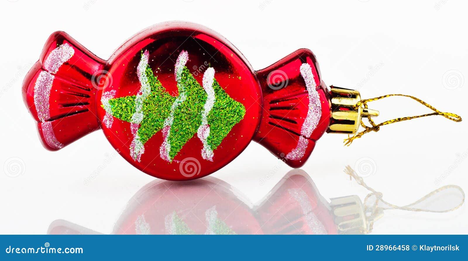 Choinki dekoracja. Czerwony cukierek.