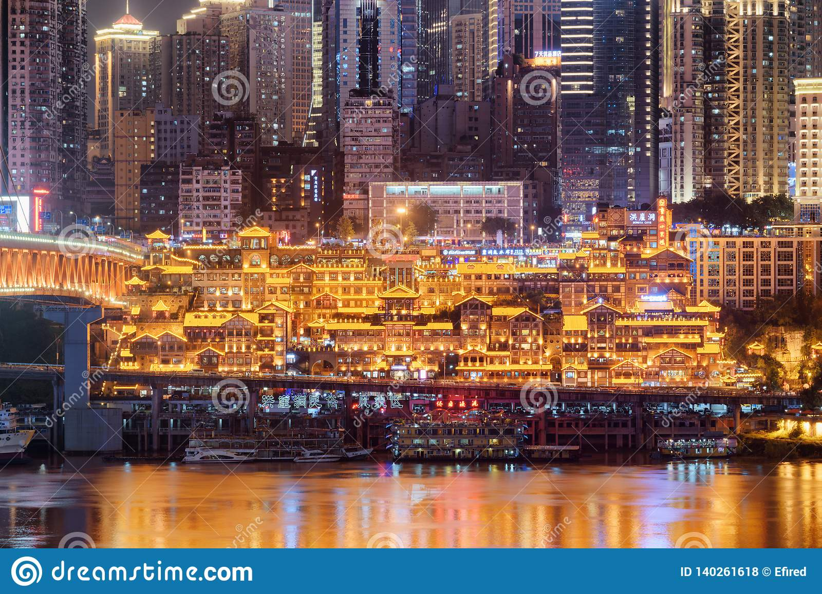Amazing night view of the Hongya Cave on skyscrapers background