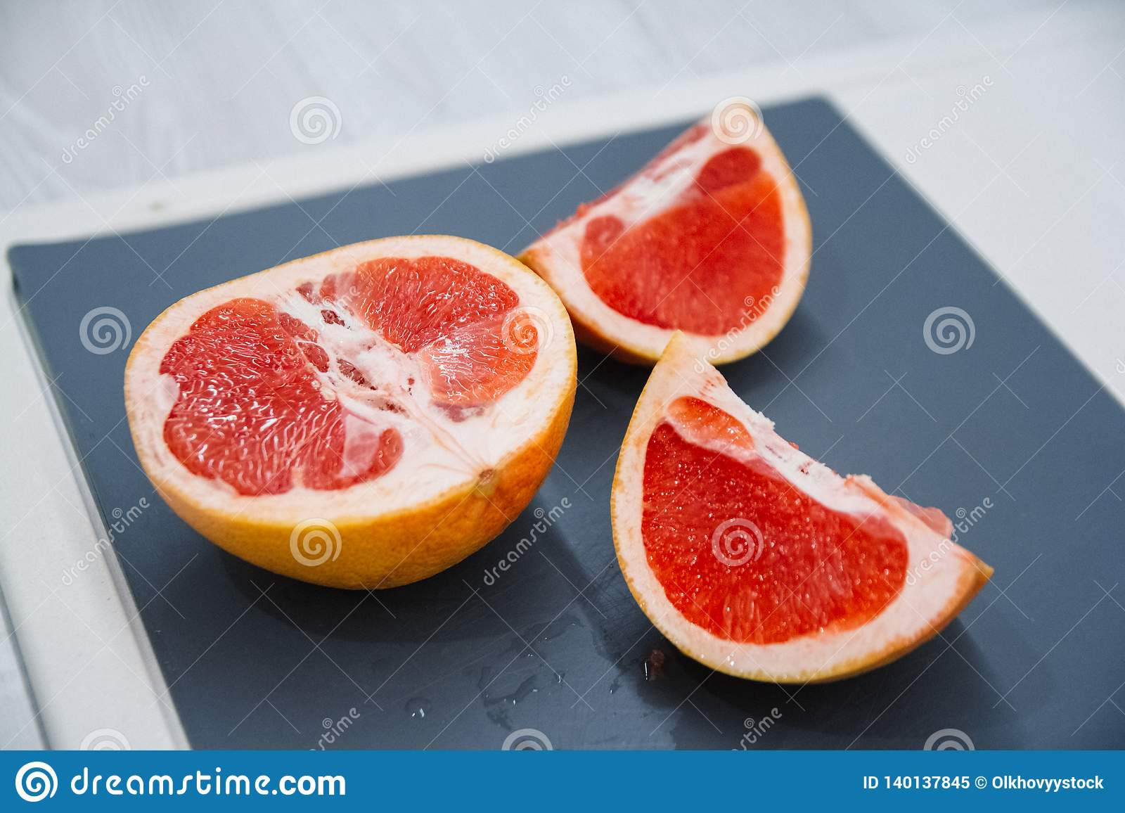 Chopped Grapefruits selective focus on a vintage background as detailed close-up shot