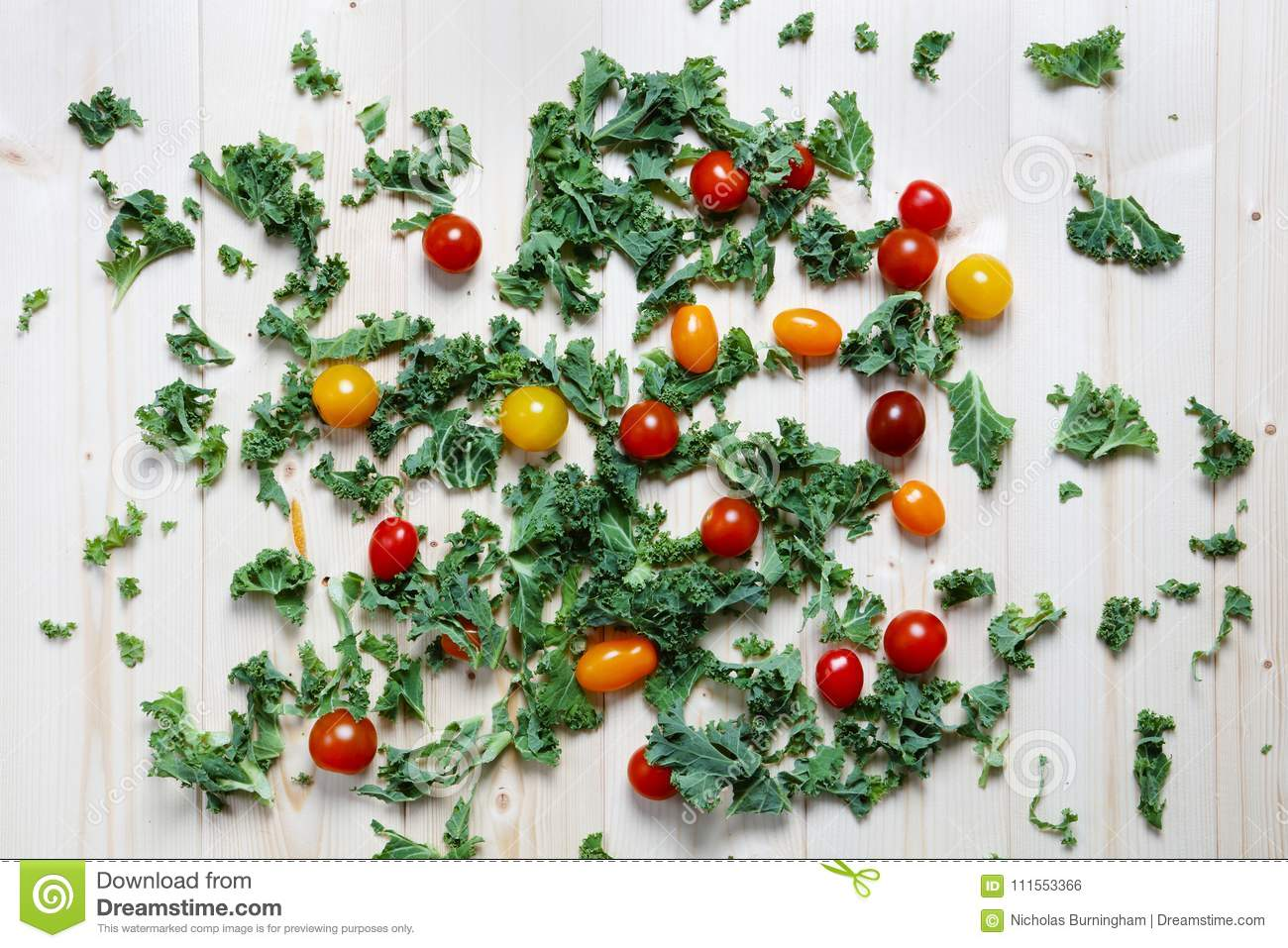Chopped green kale with red and yellow plum cherry tomatoes