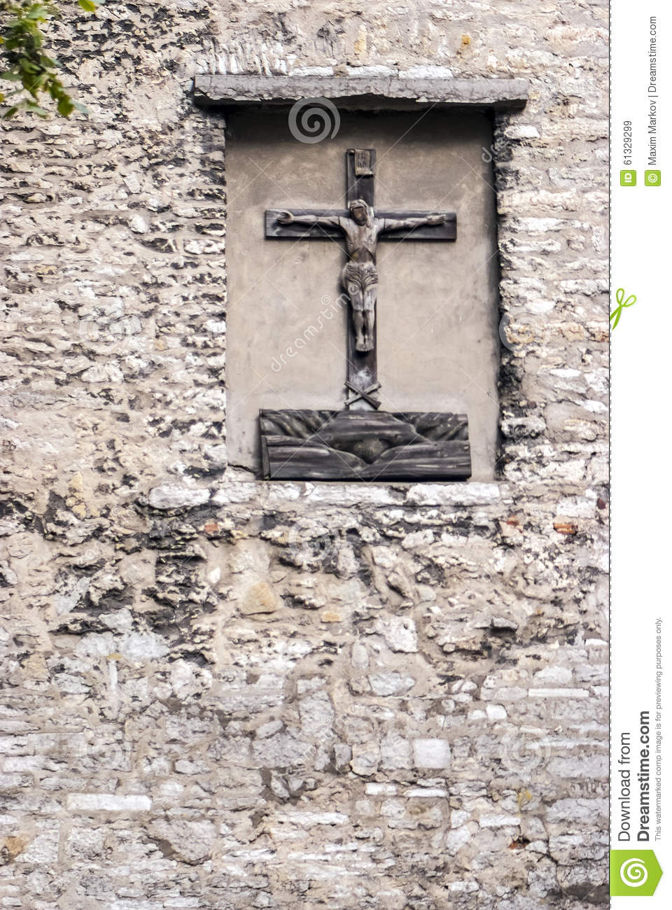 Christ statue on an ancient wall editorial stock image