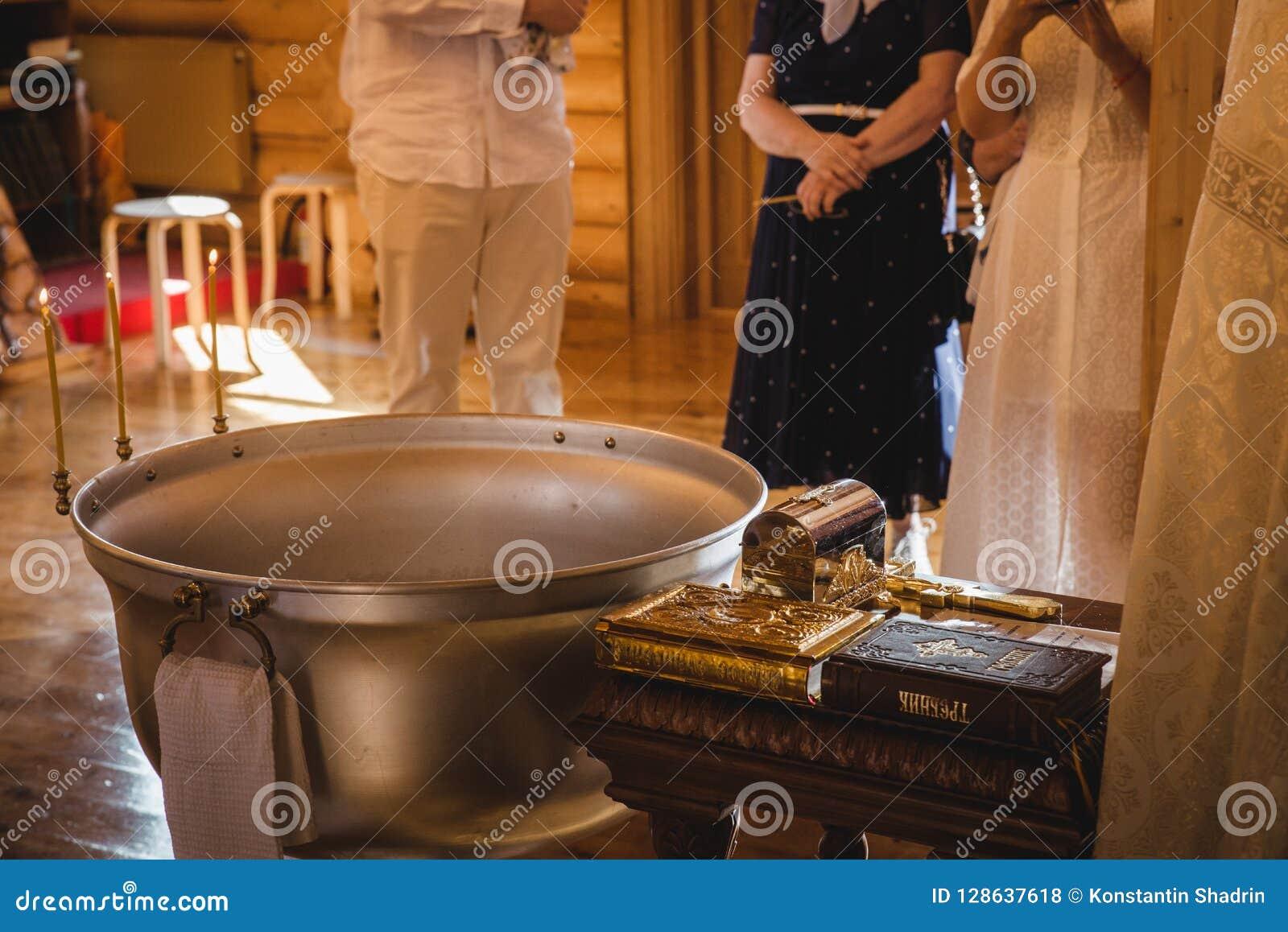 Christening Ceremony In The Orthodox Church, Priest Lighting