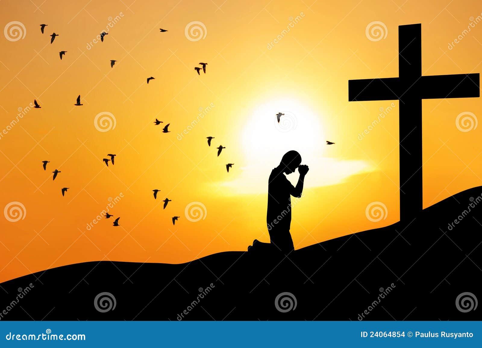 Christian background: man praying under the cross