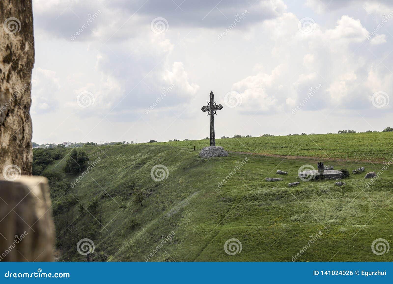Christian cross on hillside.