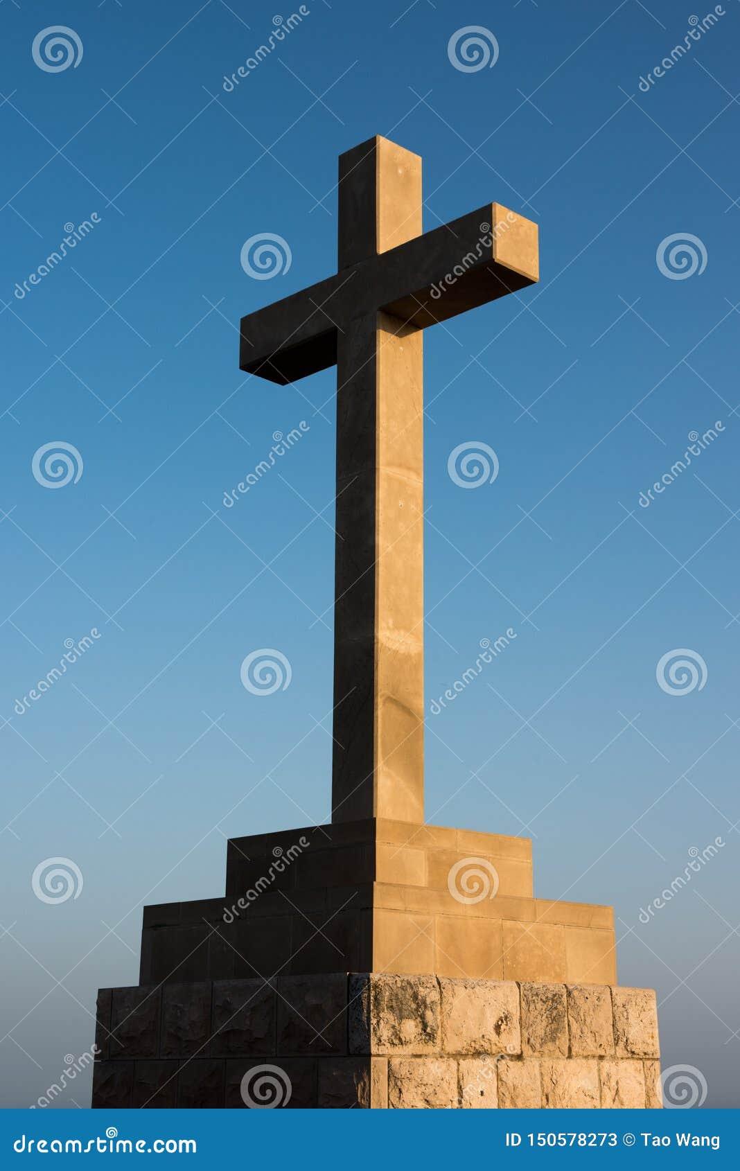 A christian cross under sunset
