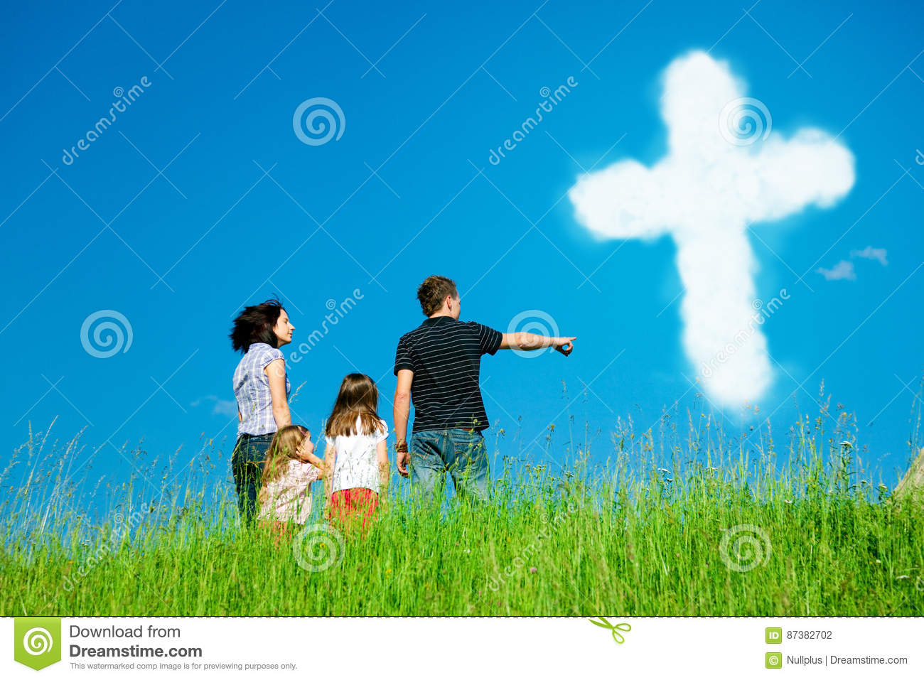 Silhouette of the holy cross on background of storm clouds stock - Christian Family Looking At Clouds Forming The Holy Cross Stock Photo