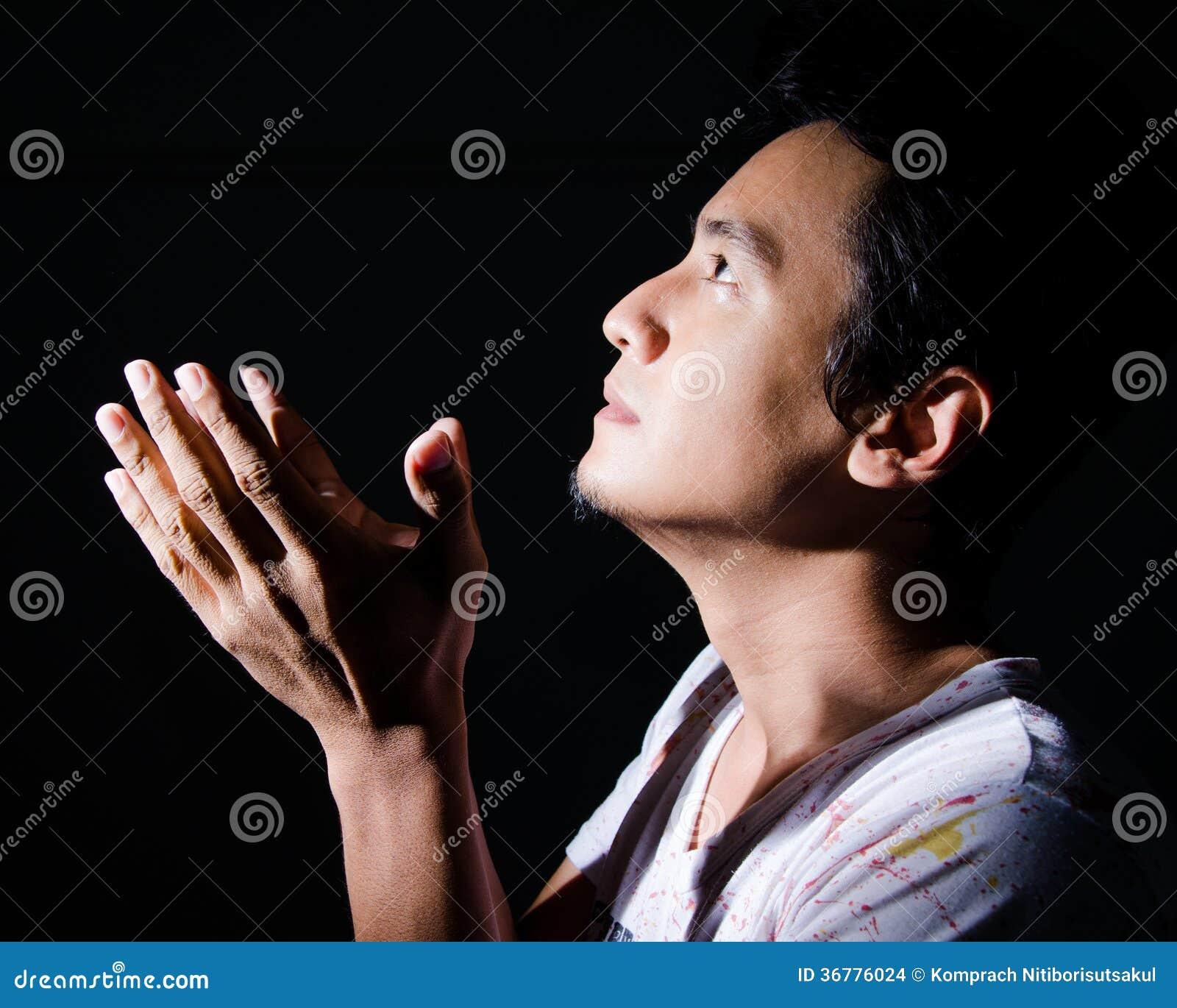 Christian man praying.