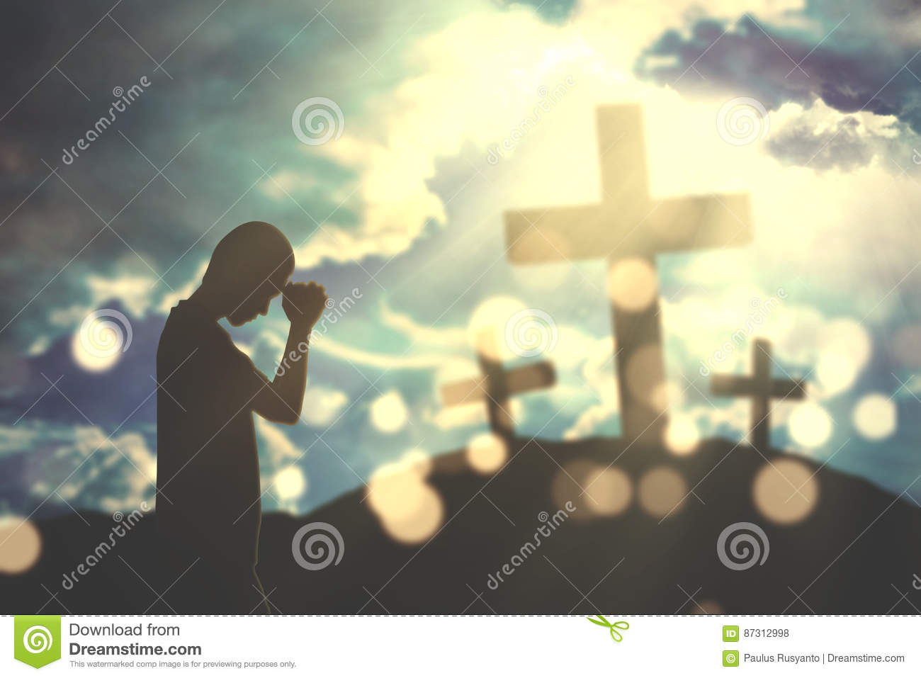 Christian man worships with cross signs