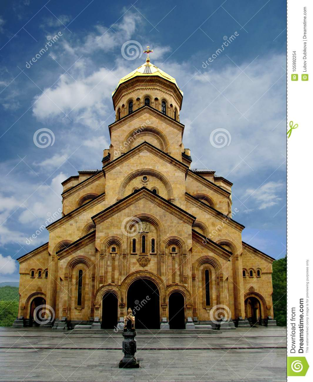 Christian stone Church with a gilded dome
