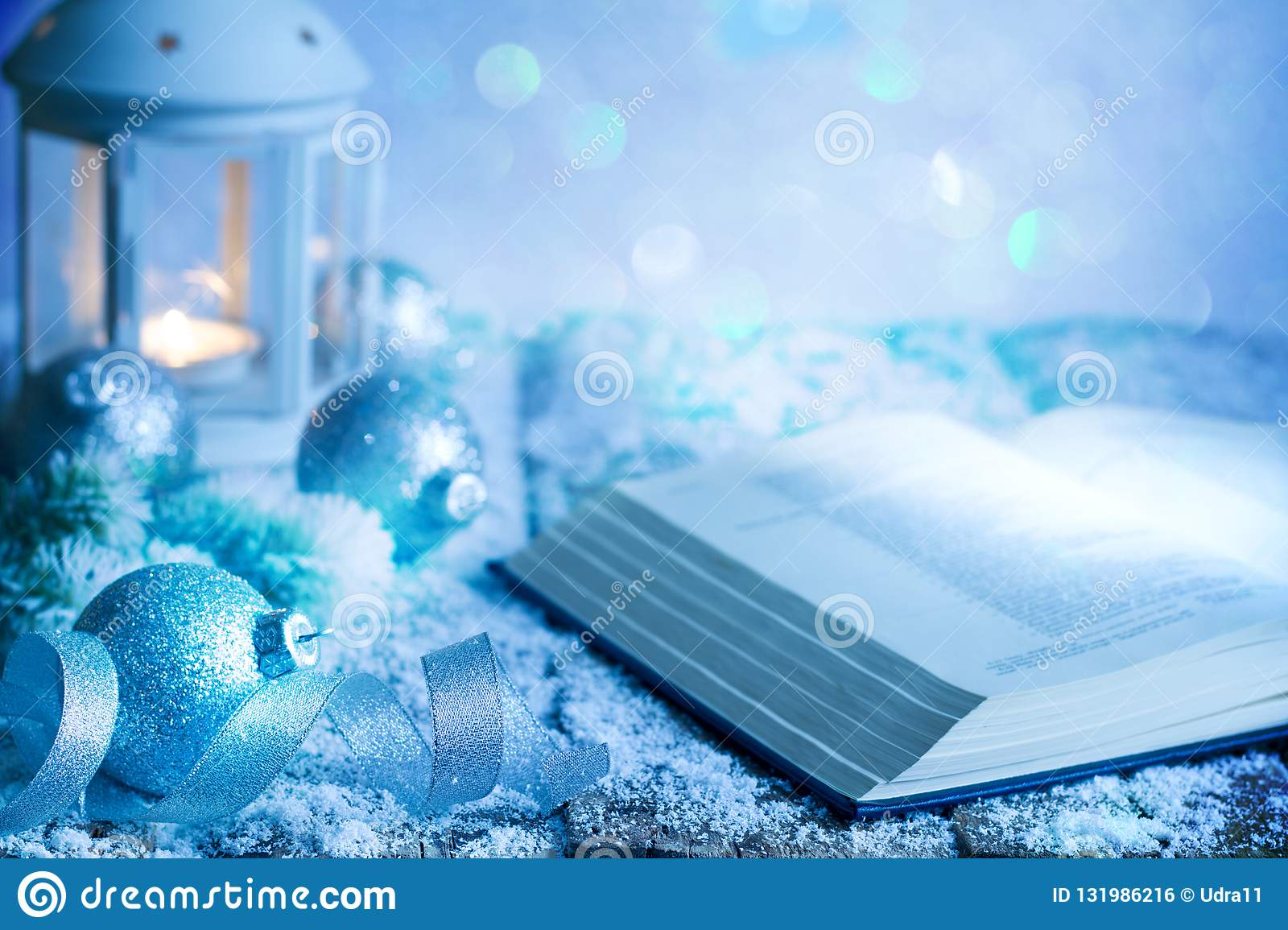 Christmas abstract decoration ornament background with bible baubles and lantern on empty table in blue