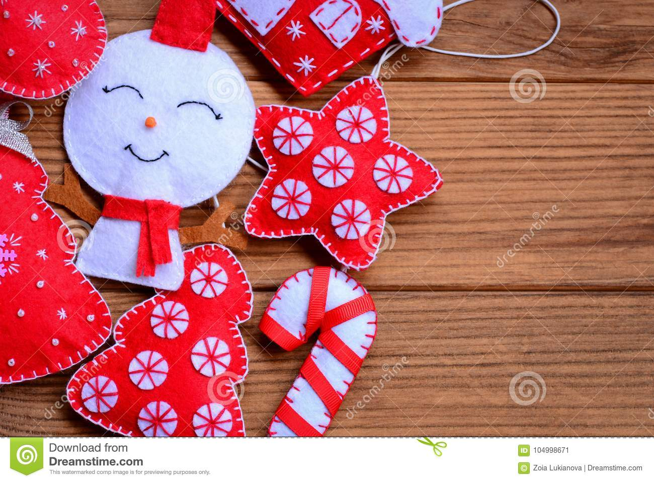 Felt Christmas Decorations On A Wooden Background With Copy Space