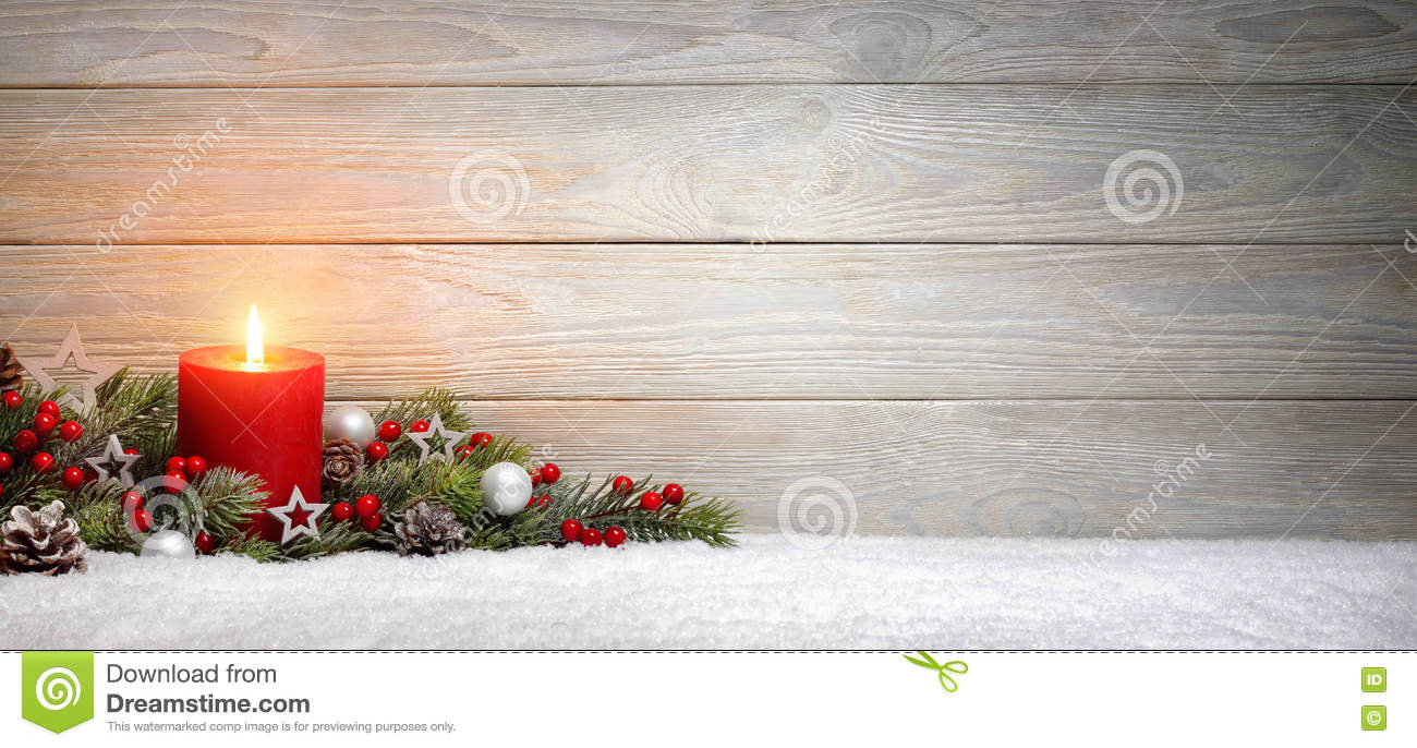 Christmas or Advent wood background with a candle