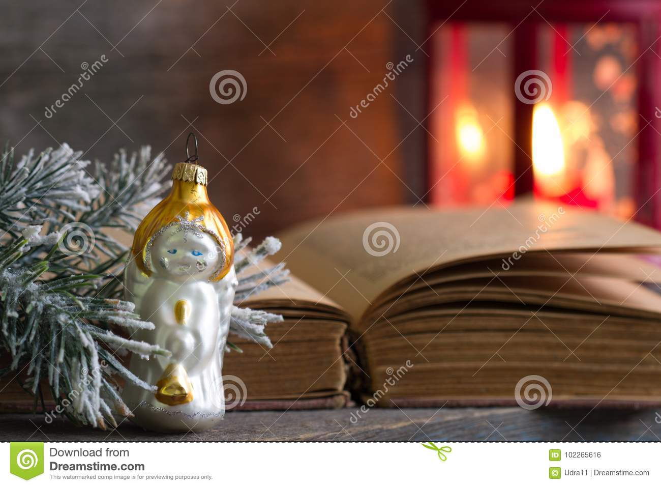 Christmas angel bible and lantern on wooden background