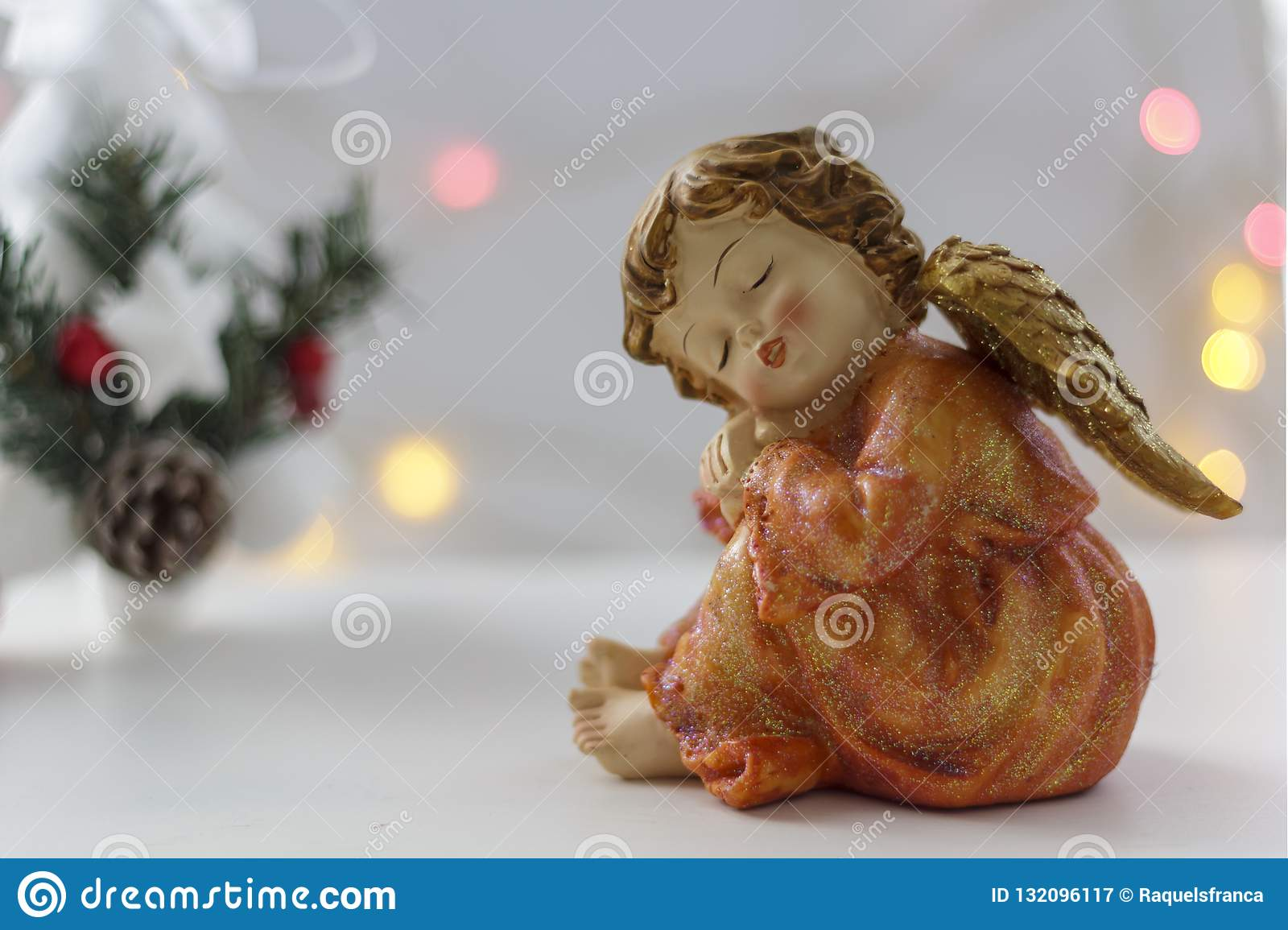 Christmas Angel and Christmas tree with bokeh lights on the background