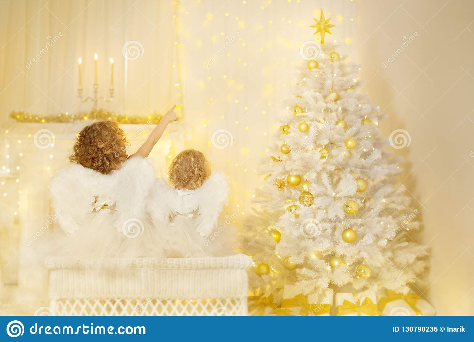 Christmas Angels looking to Xmas Tree, Children Wings on Back