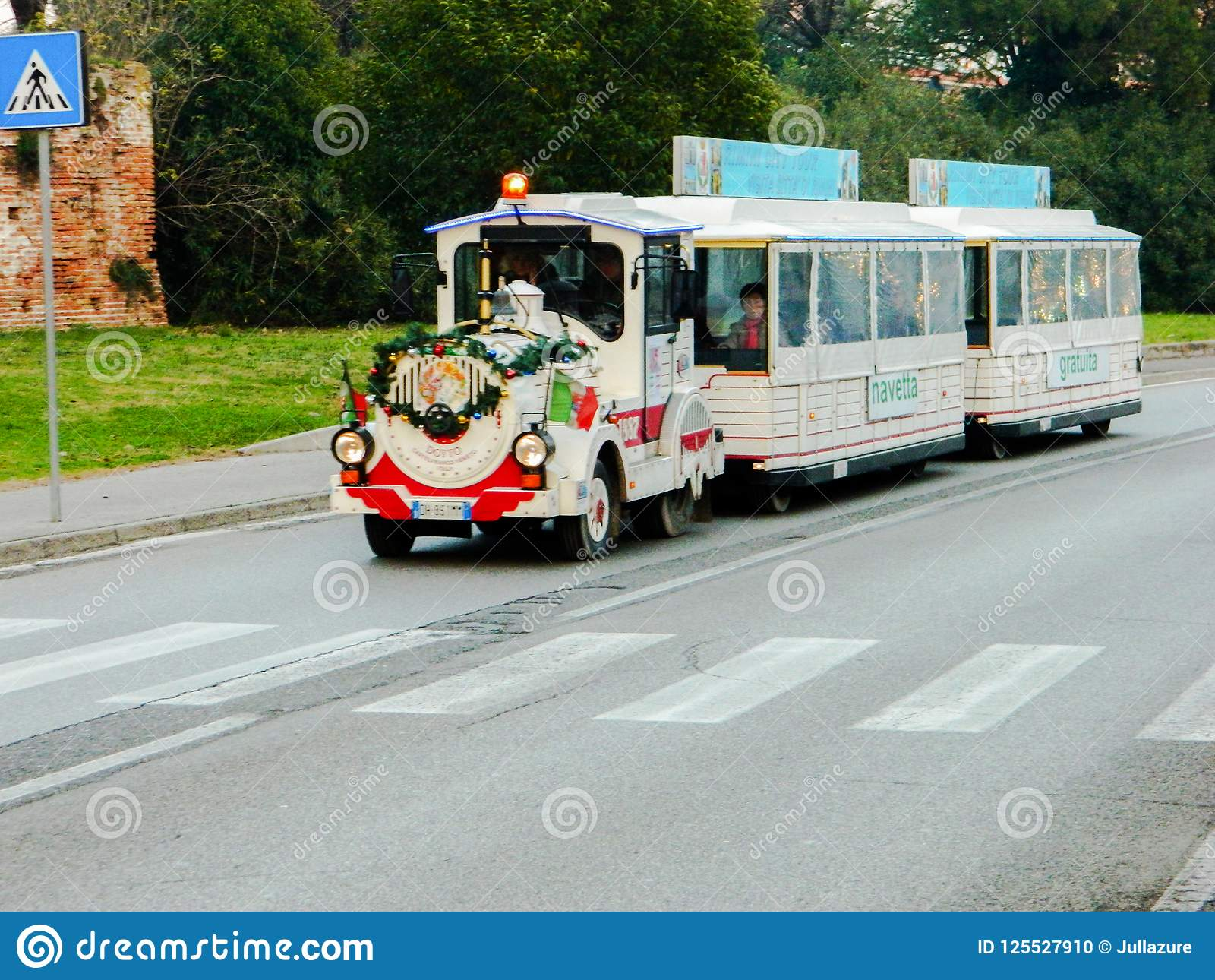 Christmas attractions, children`s train. Train of Santa Claus in Italy. A New Year`s Eve in Italy.