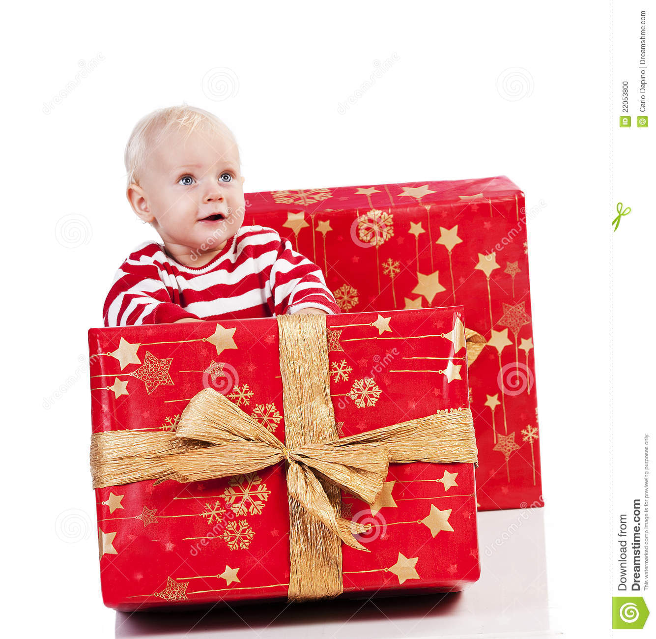 Baby Boy Gifts Christmas : Christmas baby boy with gift box is sitting stock