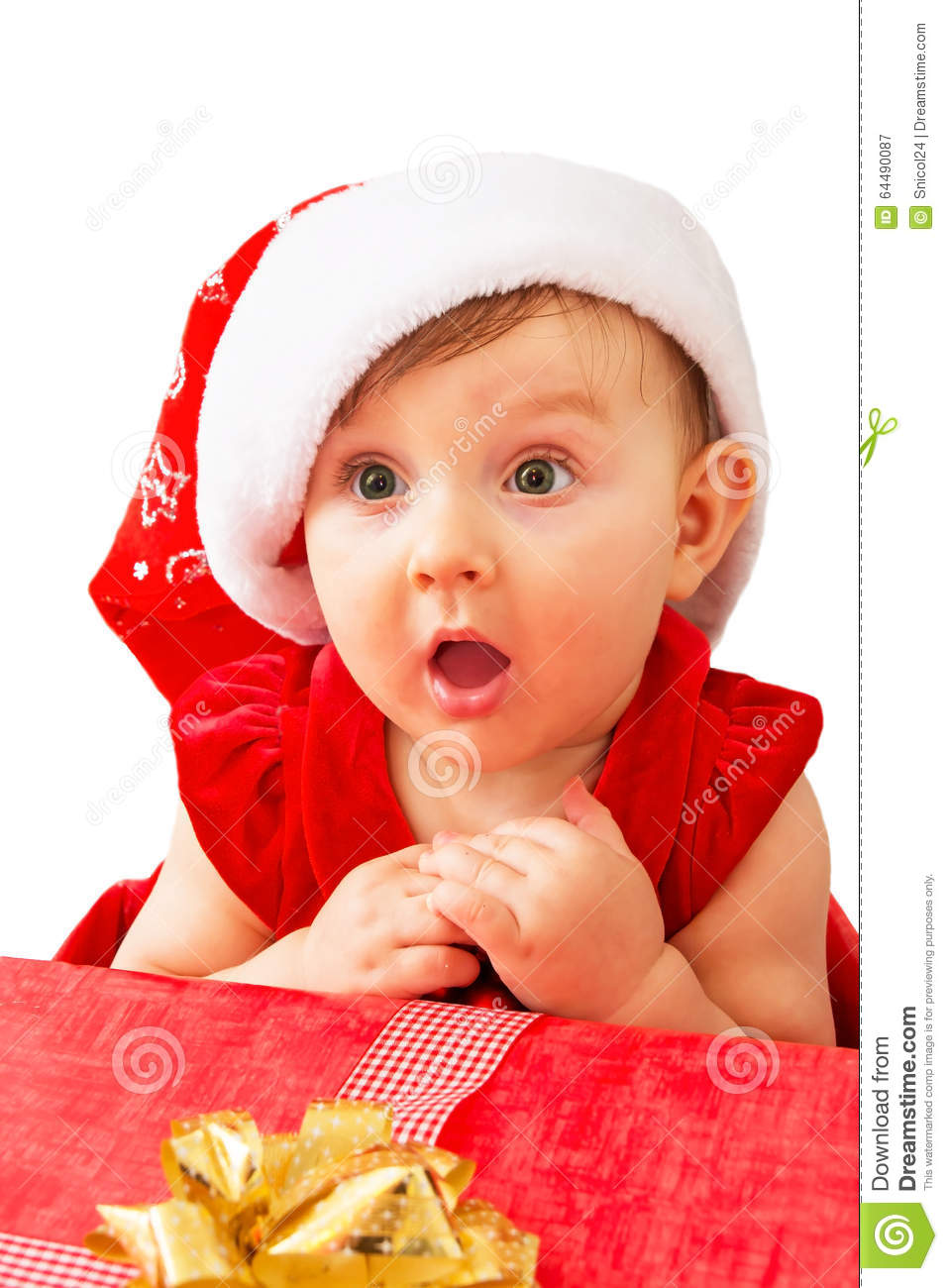 Cute christmas happy curious smiling newborn baby girl in a red dress