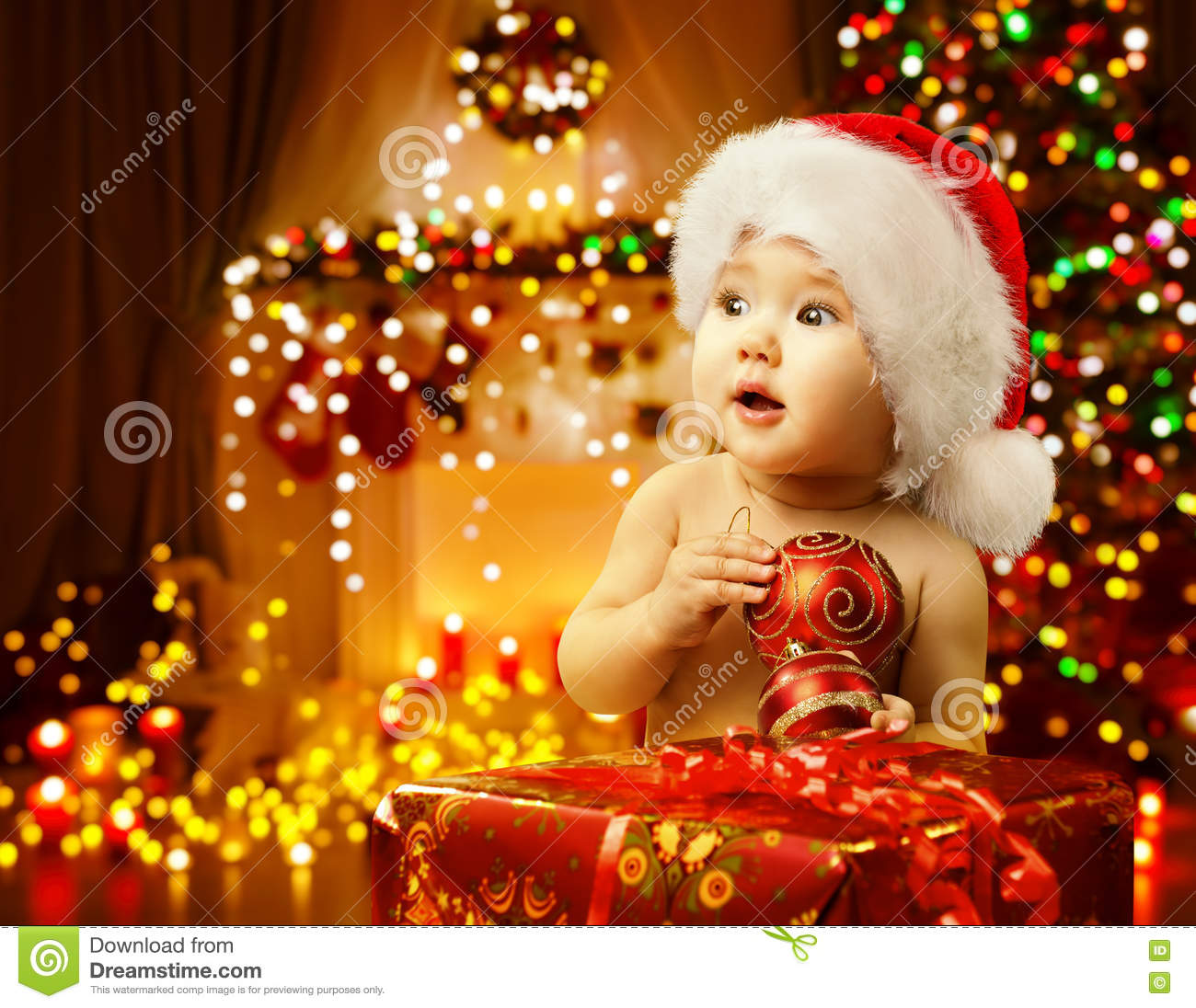 Christmas Baby Opening Present Happy Kid Santa Hat Xmas Gift Stock