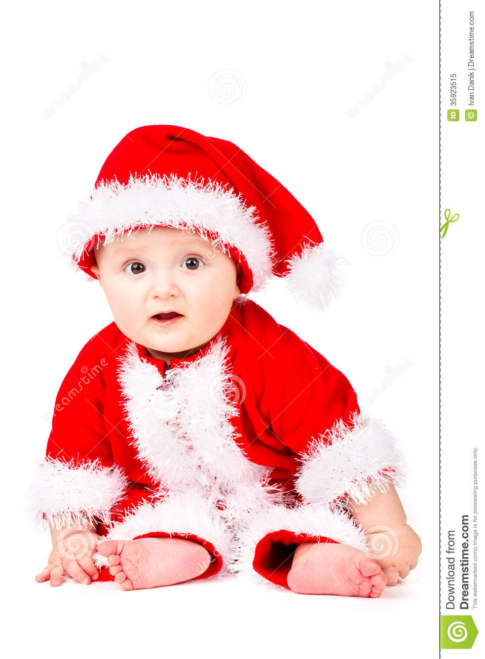 Christmas Baby In Santa Claus Clothes Royalty Free Stock
