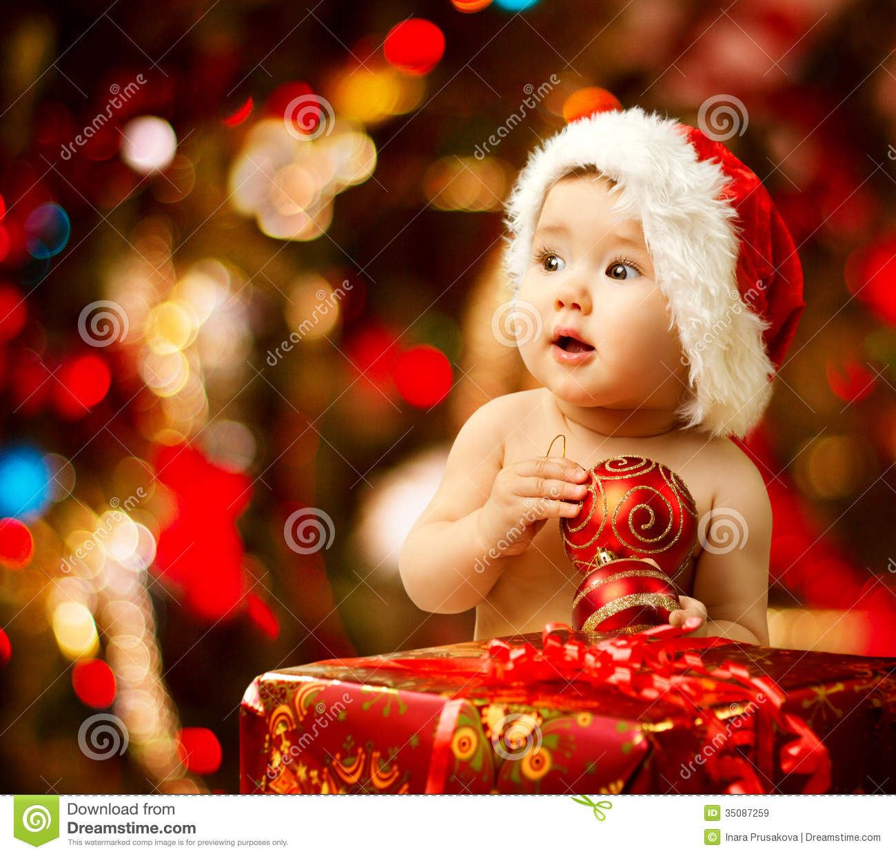 Christmas Baby In Santa Hat Red Present Gift Box Royalty Free  - Baby With Christmas Lights