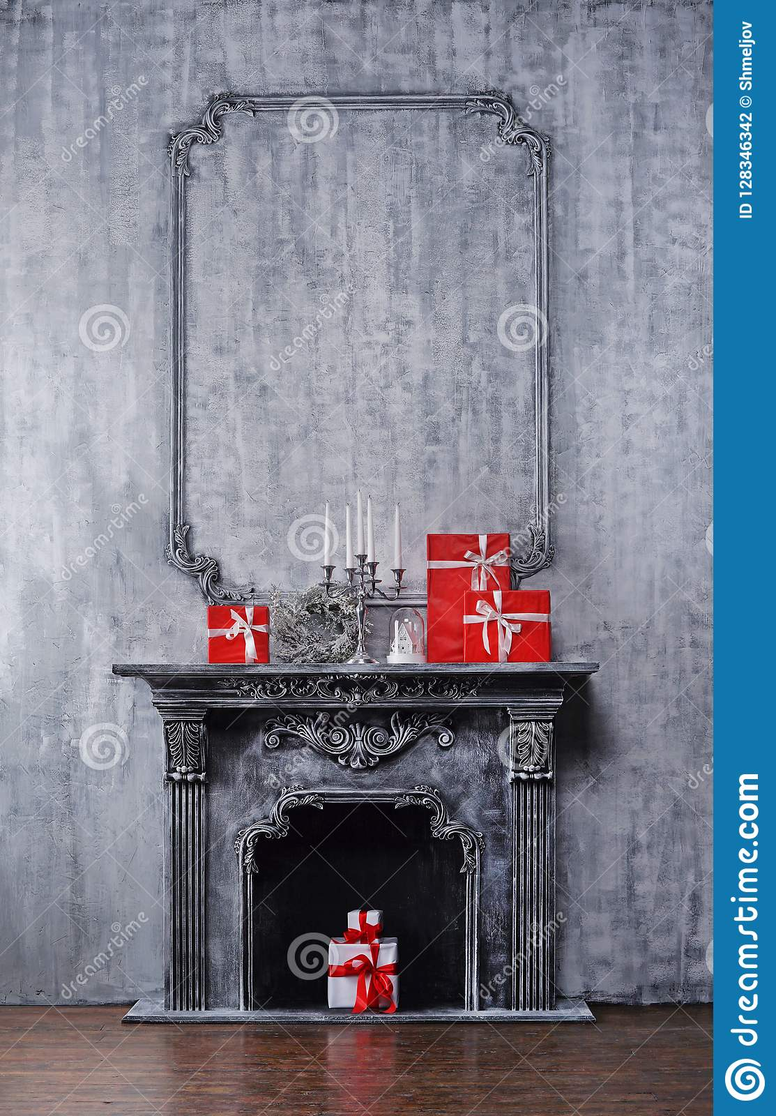 Christmas background concept. Ancient fireplace with a candlestick and gift boxes.