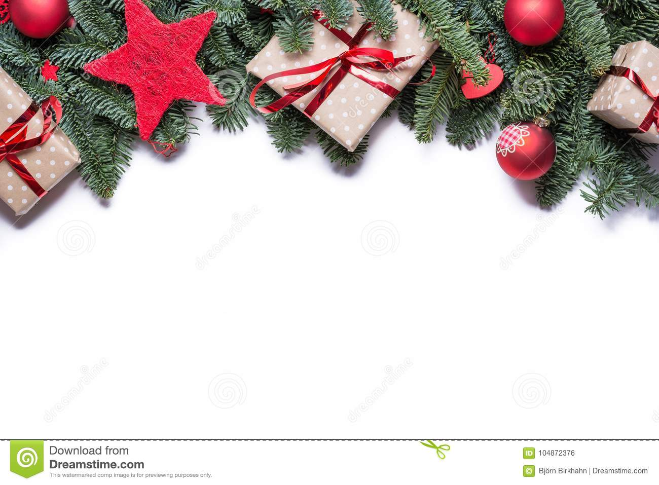Christmas background border at the top with fir branches and other decorations presents red stars and bulbs with copy space on