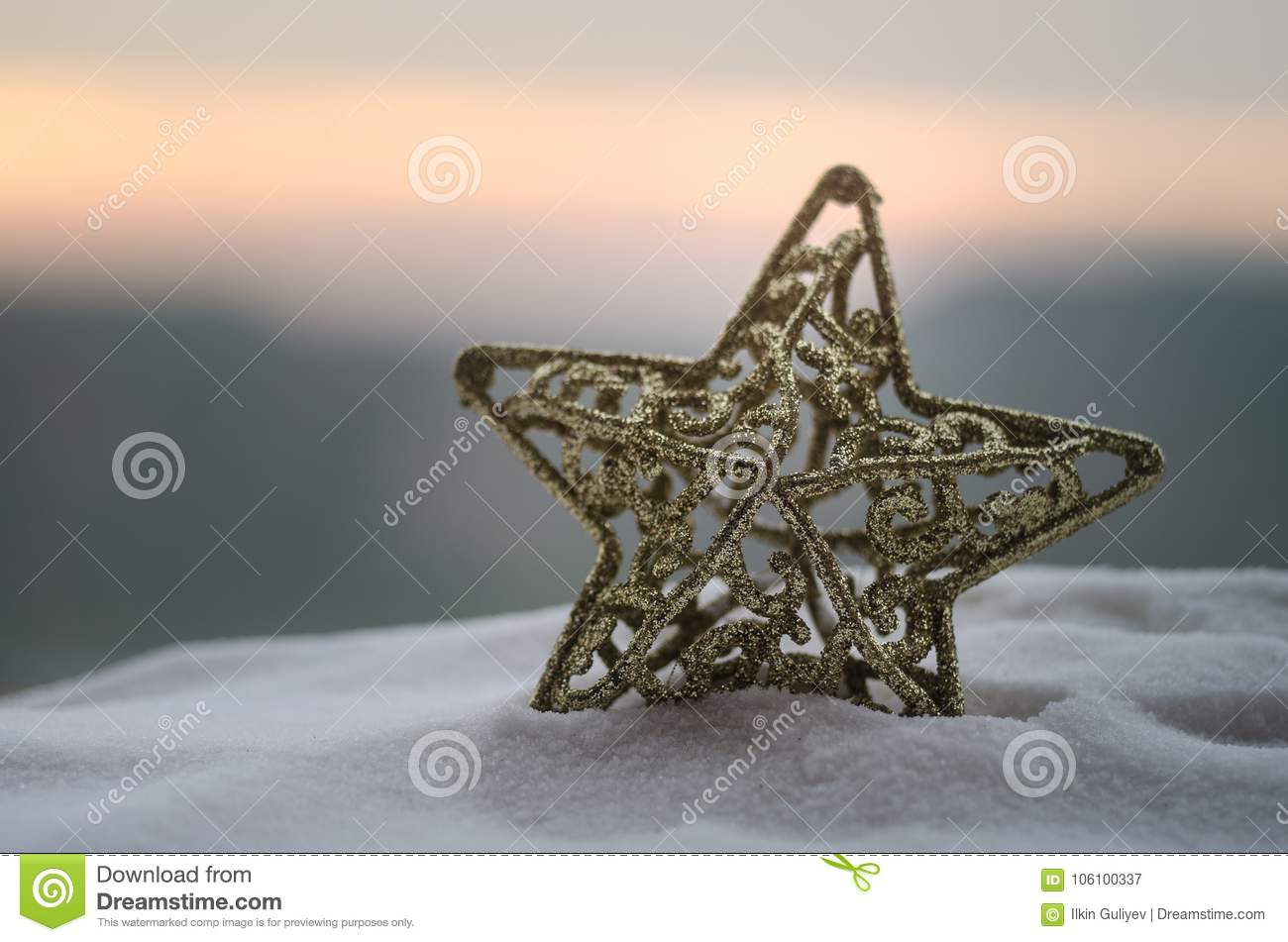 Christmas background with festive decoration, star on dark blue background with copyspace.