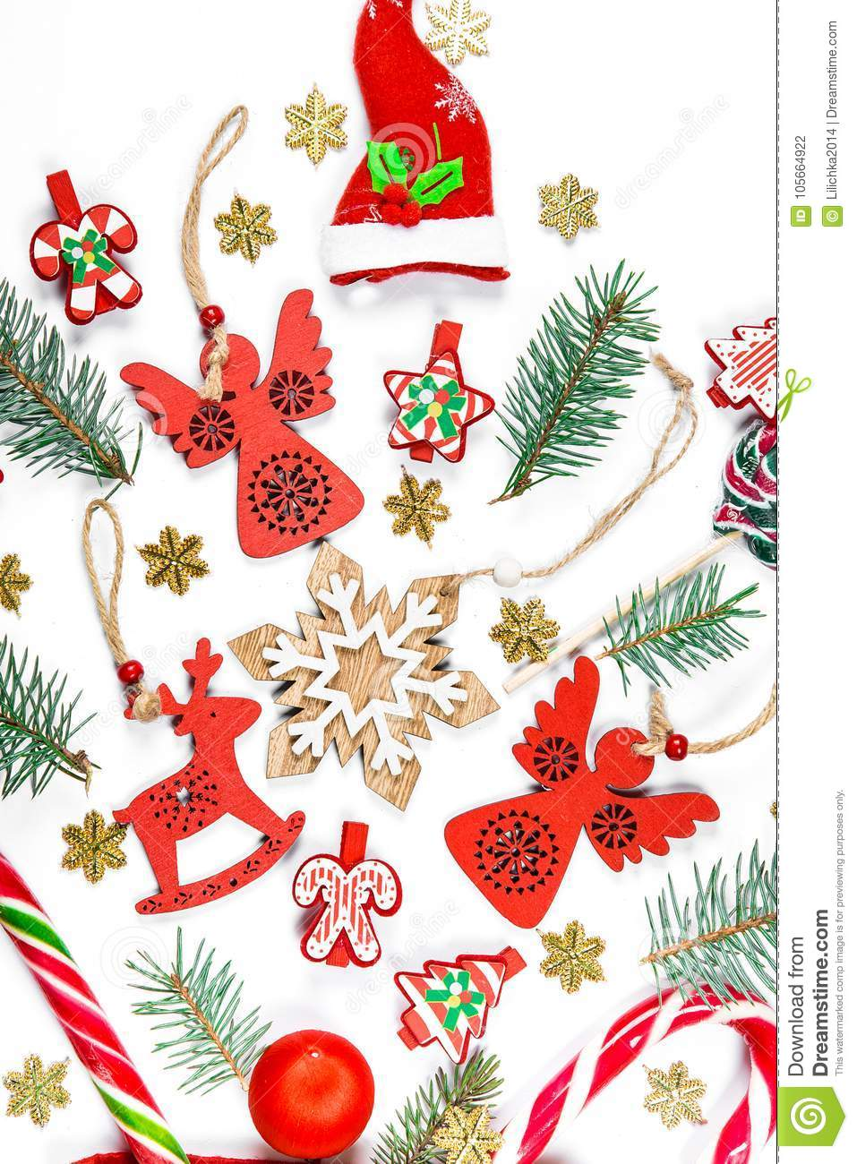 Christmas background with a santa hat, gifts, candy, New Year decorations, toys, branch of Xmas tree on a white background.