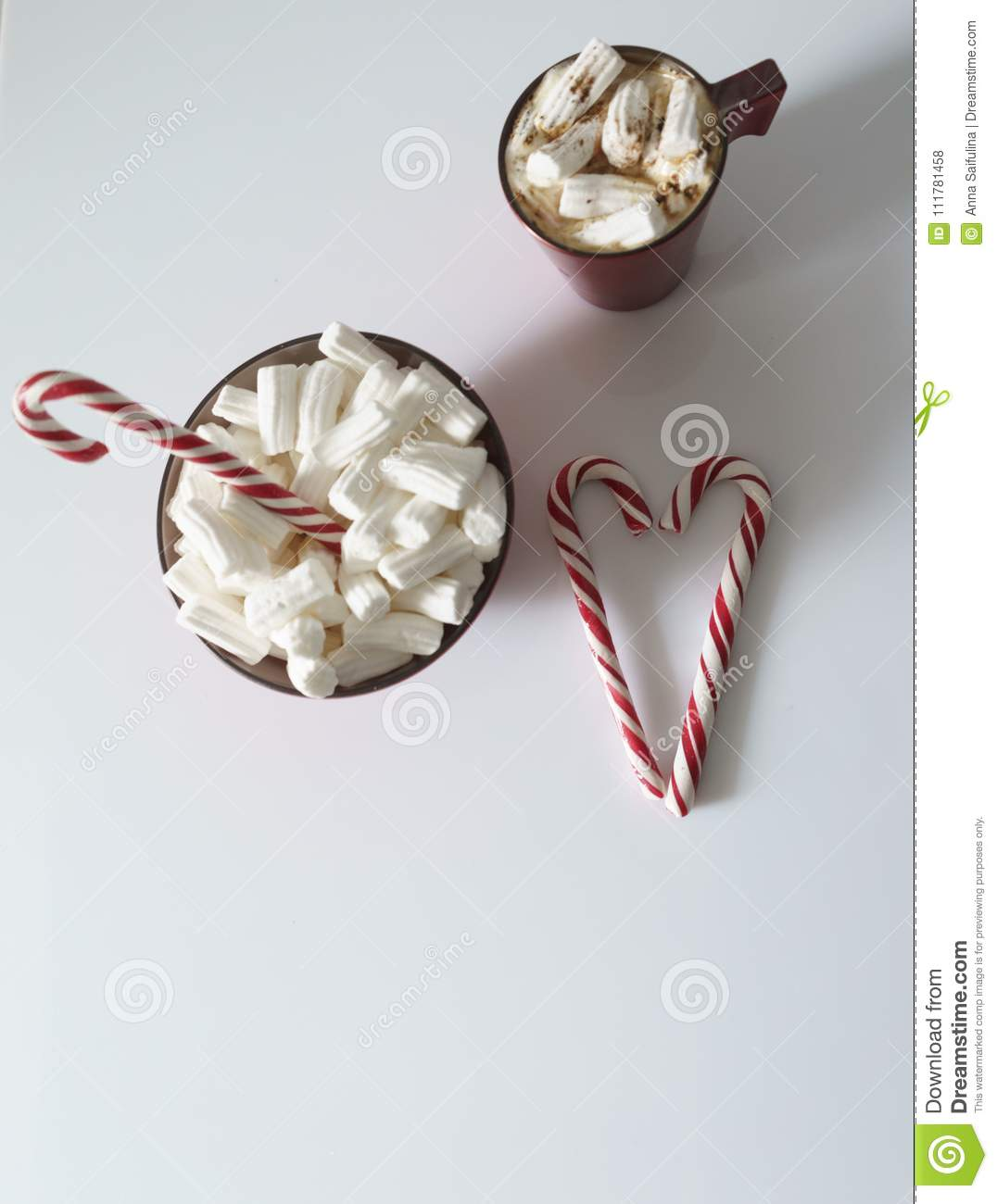 Christmas background, greeting card with a Cup of coffee or chocolate with marshmallows, lollipops and a red plate