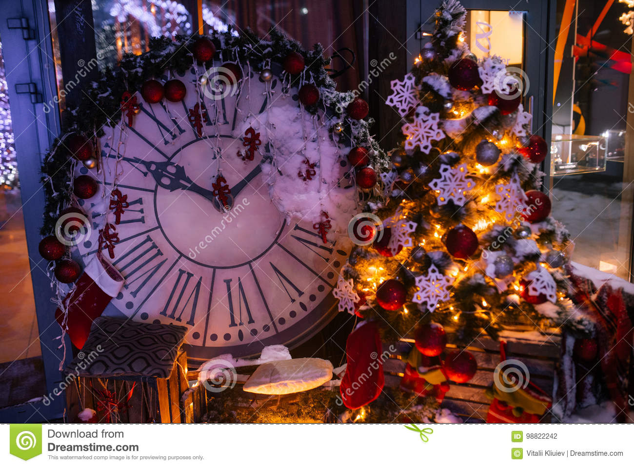 Christmas background with illuminated fir tree and fireplace, clock at house