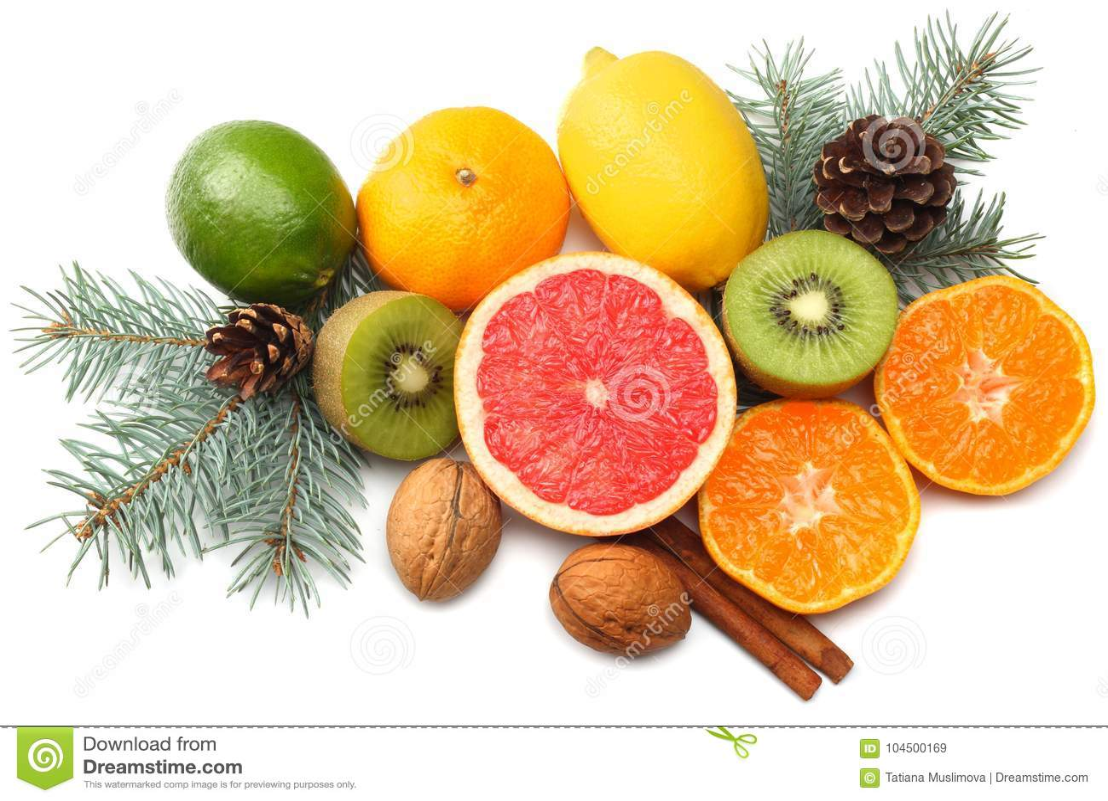 Christmas background. mix sliced lemon, green lime, orange, mandarin, kiwi fruit and grapefruit with cone and fir tree isolated