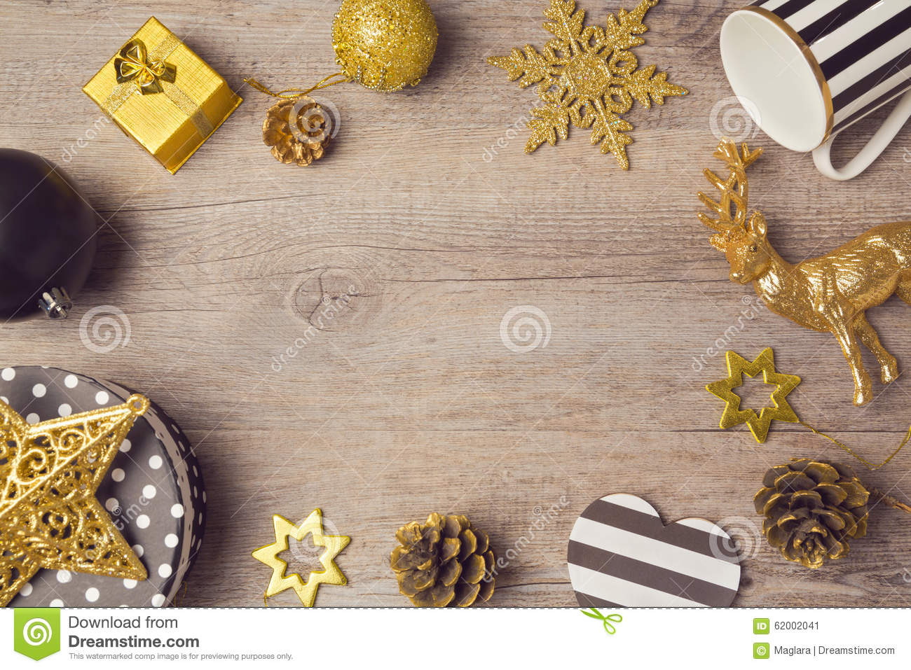 christmas background with modern black and golden decorations on wooden table  view from above