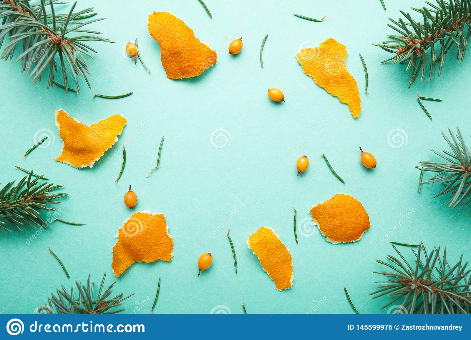 Christmas background from Natural Branches and Tangerines. Flat Lay