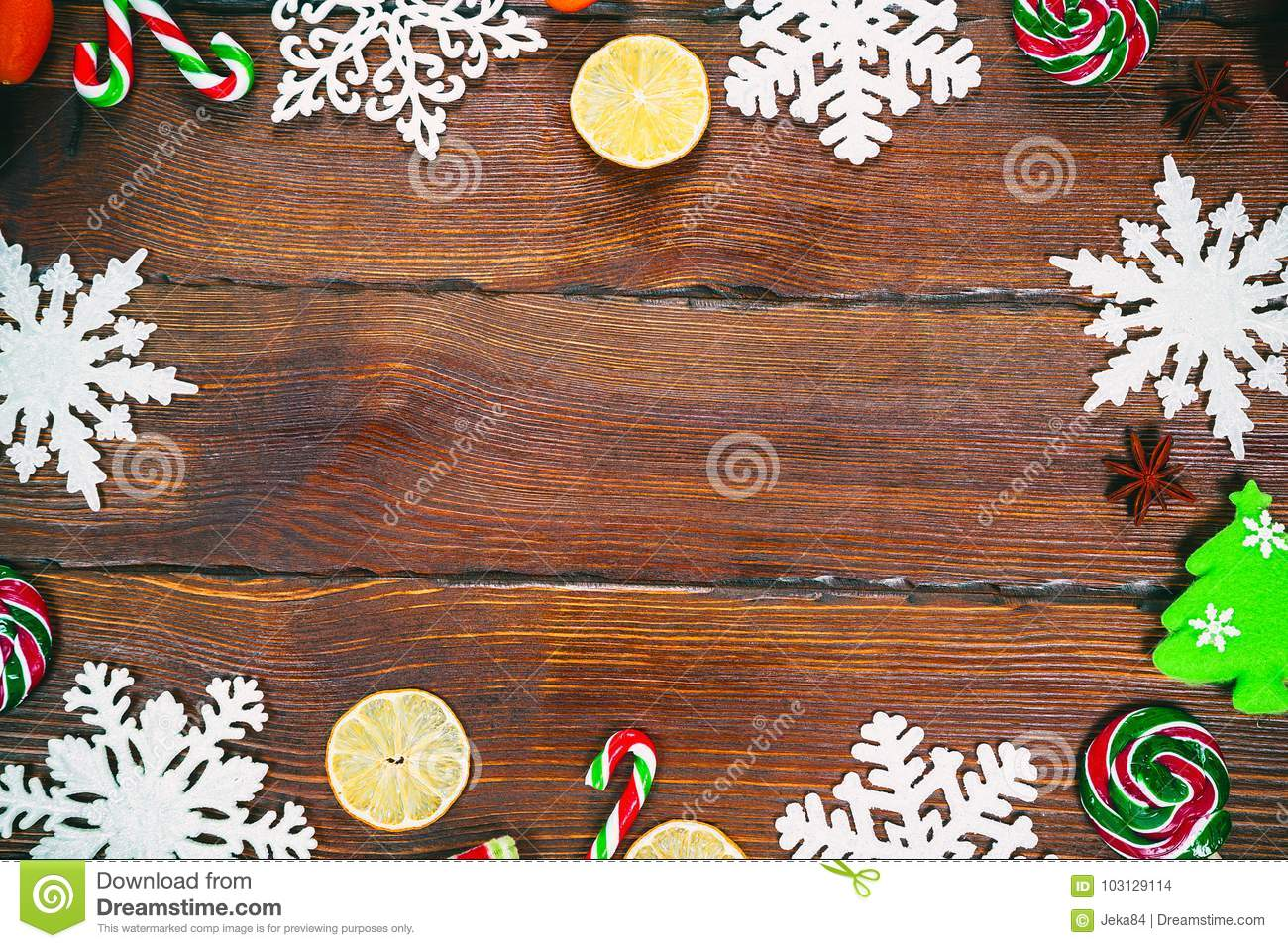 Christmas Background With Snowflakes Cones Candy Dried Oranges