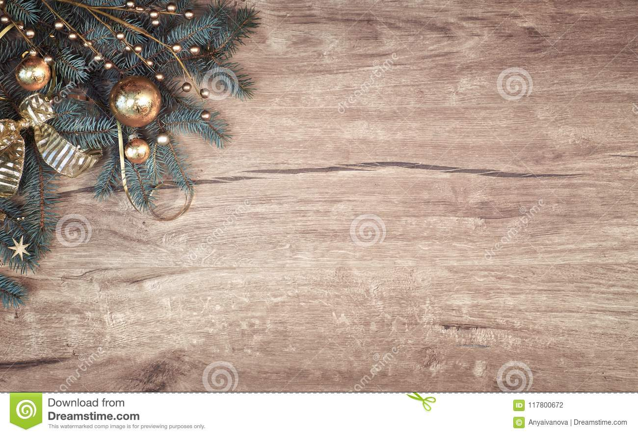 Christmas Background On Wood With A Corner Of Decorated Fir Tree
