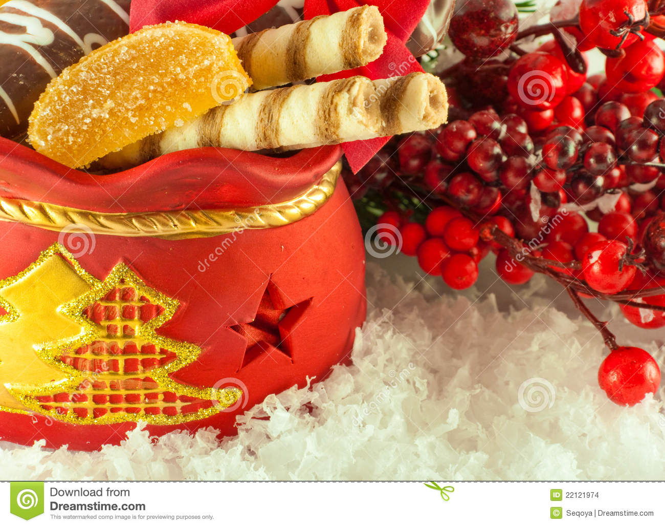 Christmas bag with gifts cookies and fruit candy a fur tree branch